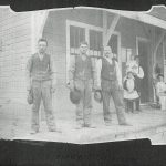 A group of men standing on the platform at the St. Mary's Railway Station, with women and children in the background – 1895.  Courtesy Galt Museum & Archives - 19760234046