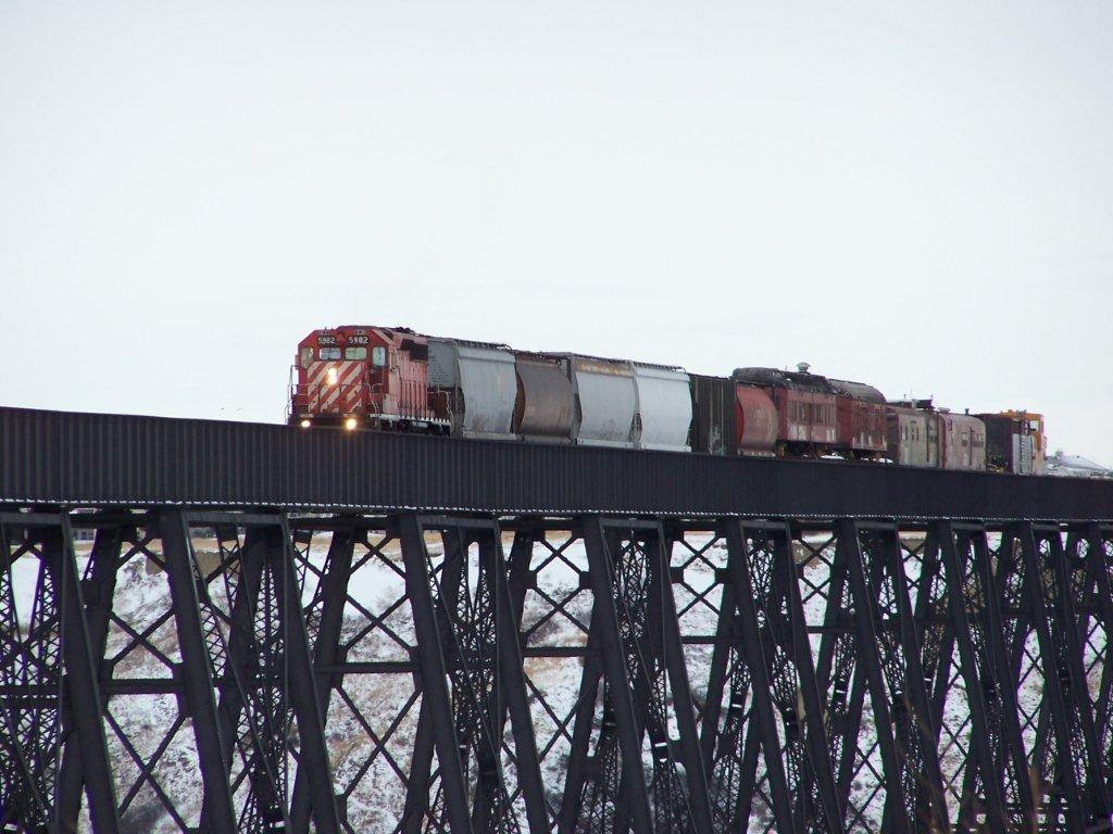 100_4417.jpg - Donated Railcars being brought over CPR High Level Trestle, Lethbridge - March 2012